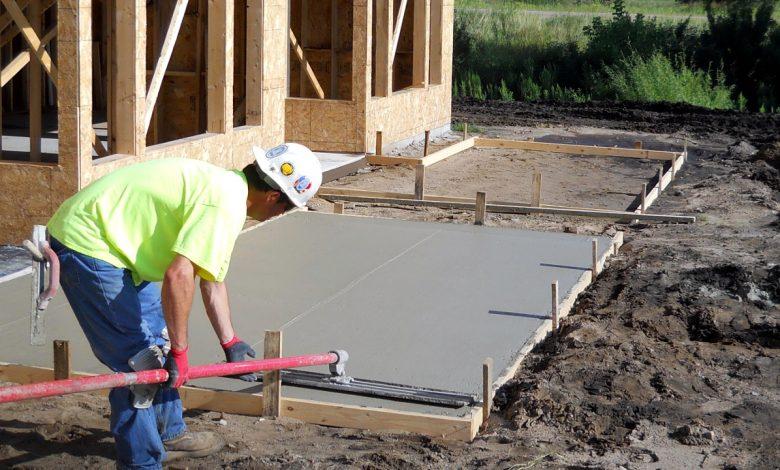 A man performing a concrete repair job